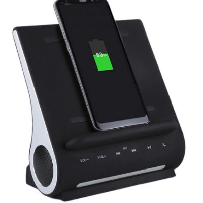 Wireless charging station with bluetooth speakers